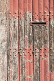 Vertical part of old wooden door with letter box and bladdered r Stock Photo