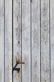 Vertical part of wooden door with old bladdered gray paint and m Stock Photography
