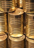 Vertical perspective line of golden metal cans Royalty Free Stock Photography