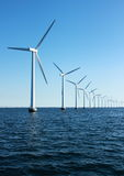 Vertical perspective of ocean windmills with horizon Stock Images