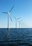 Vertical perspective of ocean windmills with horizon Stock Images