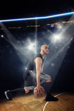 Vertical photo of bald professional basketball player in the gam Royalty Free Stock Images