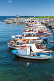 Vertical photo of colorful wooden fishing boats. Moored in small port of Avcilar, district of Istanbul, Turkey Stock Photography