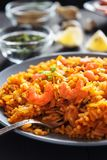 fried rice with shrimps, lemon and vegetables on grey plate close up Stock Images