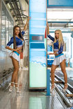Vertical photo of leggy girls posing at car wash Royalty Free Stock Photo
