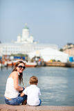 Vertical photo of mother and son in city Stock Image
