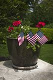 Vertical Photo of Small Flags in Flower Pot stock photography