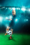 Vertical photo of soccer player shooting a ball in the game Stock Images