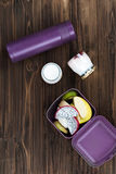 Vertical photo of violet thermos lying on the table Stock Photo
