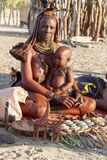 Himba mom with her baby in her arms. Namibia