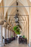 Vertical picture arch building in the center of Krakow shopping. Arcade Stock Photography