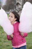 Vertical picture of a girl with cotton candy Stock Images