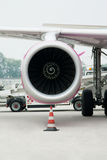 Vertical picture shows the engine of the aircraft, which stands. At the airport Stock Photos