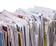 Vertical pile of newspapers and flyers Stock Photos