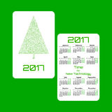 Vertical pocket calendar for 2017 year. Week starts Monday. Double-sided calendar for 2017 year. Yearly calendar template with text 2017, Christmas tree and Stock Photography