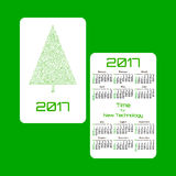Vertical pocket calendar for 2017 year. Week starts Sunday. Double-sided calendar for 2017 year. Yearly calendar template with text 2017, Christmas tree and Stock Photo
