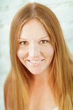 Adorable smiling red-haired freckled young woman Stock Photo