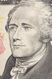 Vertical portrait of Alexander Hamilton`s face on the US 10 dollar bill. Macro shot.  stock image