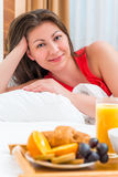 Vertical portrait of a brunette in bed Royalty Free Stock Image