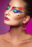 Vertical portrait of cute adult girl with multicolor make up on Royalty Free Stock Photography