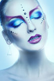 Vertical portrait of cutie woman with multicolor make up in stud Stock Photography