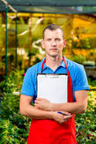 Vertical portrait of an entrepreneur in a greenhouse Royalty Free Stock Photos