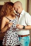 Vertical portrait of flirting beautiful couple at party Stock Photography