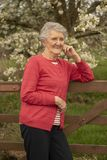 Portrait of happy senior woman outdoors. Vertical portrait of happy senior woman outdoors stock photography