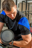Vertical portrait of a man with dumbbells Stock Photography