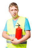 Vertical portrait of a man in a vest with a fire extinguisher Stock Photo