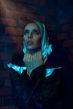 Vertical portrait of nun nera brick wall Royalty Free Stock Images