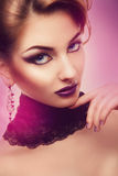Vertical portrait of serious woman with violet make up Royalty Free Stock Images