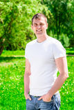 Vertical portrait of a sporty man in park Royalty Free Stock Photography