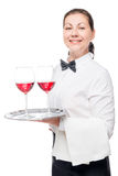 Vertical portrait of a waitress with alcoholic drinks on a tray Royalty Free Stock Images