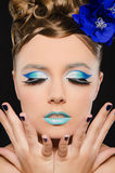 Vertical portrait of woman with blue make-up Stock Photos