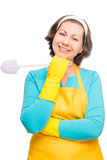 Vertical portrait of a woman housewife with toilet brush Royalty Free Stock Photo