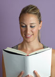 Vertical portrait of a woman reading textbook Stock Photo