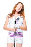 Vertical portrait of a 30 year old girl with a golf club Stock Image