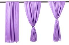 Vertical purple satin curtains isolated on white. Background stock images
