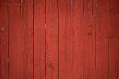 Vertical red barn boards and planks background. Vertical oxblood red barn door boards and planks background. One red hinge Royalty Free Stock Image