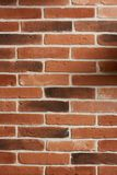 Vertical red brick wall. Texture background. Clean red brick block wall Stock Photography