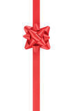 Vertical red ribbon with gift bow isolated on Stock Image