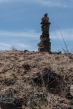 Vertical of rock cairn along state highway nine in southwest New Mexico. royalty free stock photos