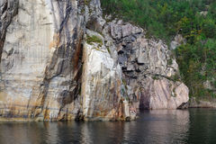 Vertical rock formation in water Stock Photo