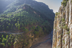 Vertical rock wall and road at Gorge of the Gaitanes. Malaga, Spain royalty free stock photography