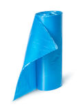 Vertical roll of blue plastic garbage bags Stock Image