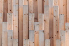 Vertical row of new wooden girders Royalty Free Stock Images