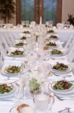 Vertical: Salads Served on White Table Cloth for Wedding Reception Royalty Free Stock Photos