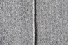 Vertical seam on cloth. Close up of seam on cotton jersey Royalty Free Stock Photography