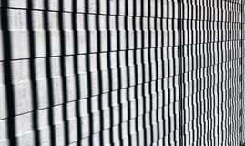 Vertical shadows on wooden slats. Abstract pattern in black and white. The background of the cross section is wooden slats and vertical shadows Royalty Free Stock Images